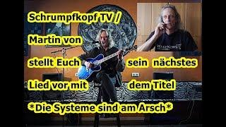 Trailer: Schrumpfkopf TV / Martin mit seinem neuen Lied Die Systeme sind am Arsch