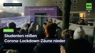 Manchester: Studenten reißen Corona-Lockdown-Zäune nieder