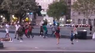 A bunch of illegal African street dealers hit an American tourist in Barcelona, Spain