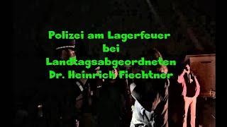 Polizei am Lagerfeuer  bei  Landtagsabgeordneten Dr. Heinrich Fiechtner