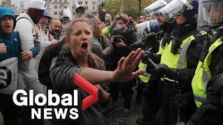 Coronavirus: Anti-lockdown protesters clash with police in London's Trafalgar Square
