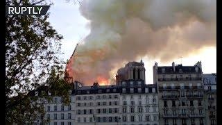 Moment Notre Dame Cathedral's spire collapses