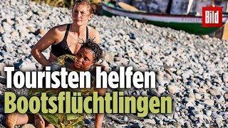 Strandurlauber helfen gestrandeten Migranten in Gran Canaria