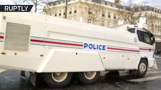 Police deploy water cannon during Yellow Vest protest in Paris